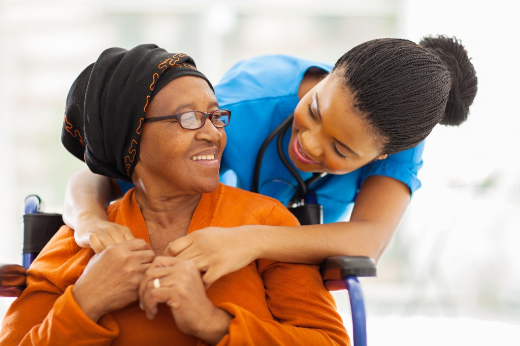 caregiver with a patient in wheelchair