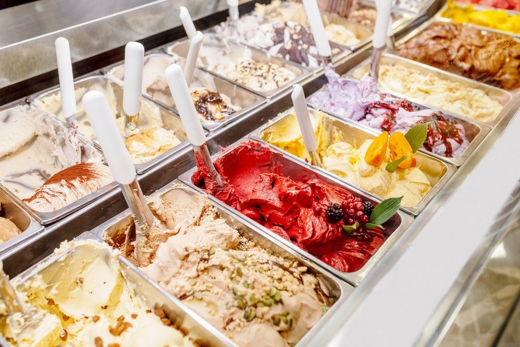 different flavors of gelato in containers