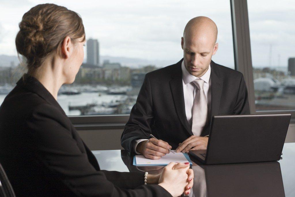 businesswoman talking to a man