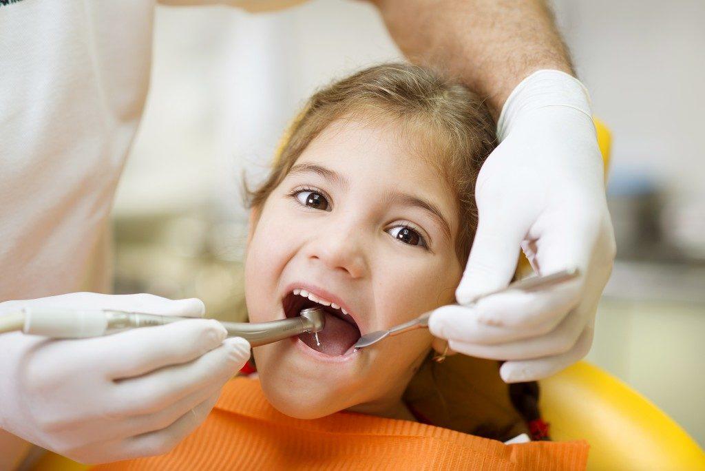 little girl at the dentist