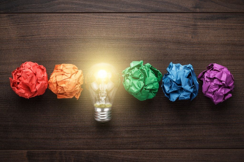 colored papers and a lightbulb