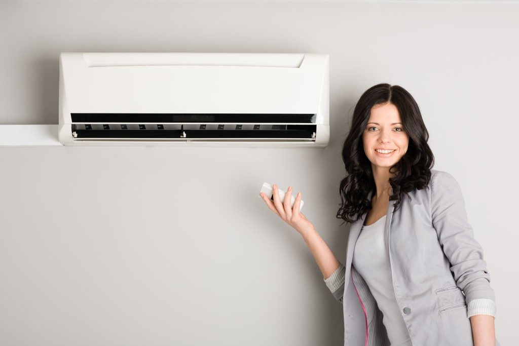 woman with an air conditioner