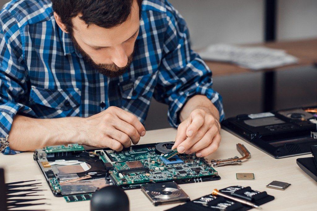 Man fixing computer parts