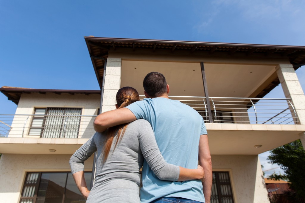 couple looking at their new house
