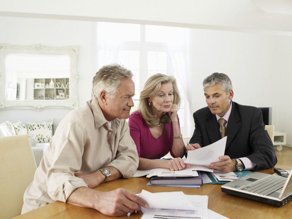 seniors with financial advisor