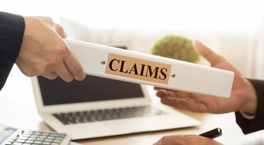person handing claims folder