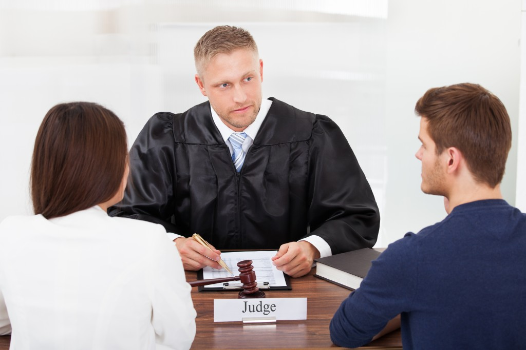 judge talking to a couple
